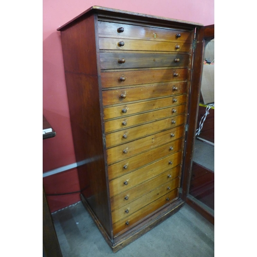 14 - A Victorian mahogany museum collectors cabinet, with single glazed door revealing thirteen drawers