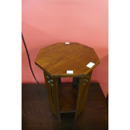 15 - An Arts and Crafts oak jardiniere stand