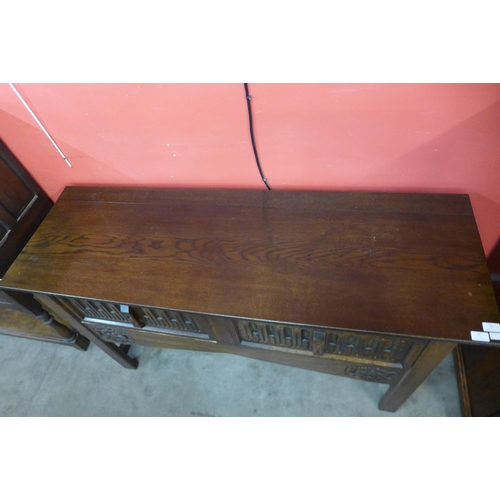 17 - A 17th Century style carved oak two drawer dresser