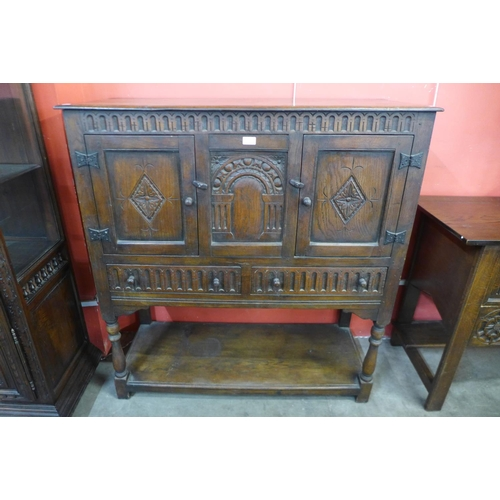 18 - A 17th Century style carved oak credence cupboard