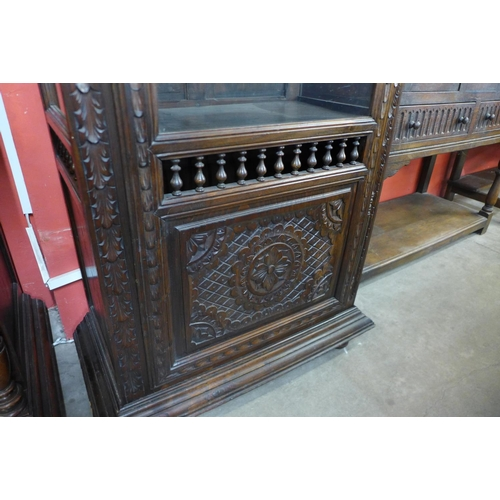 19 - A French carved oak single door vitrine
