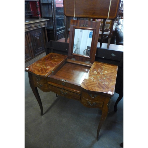 23 - A French Louis XV style kingwood and marquetry effect lady's dressing table
