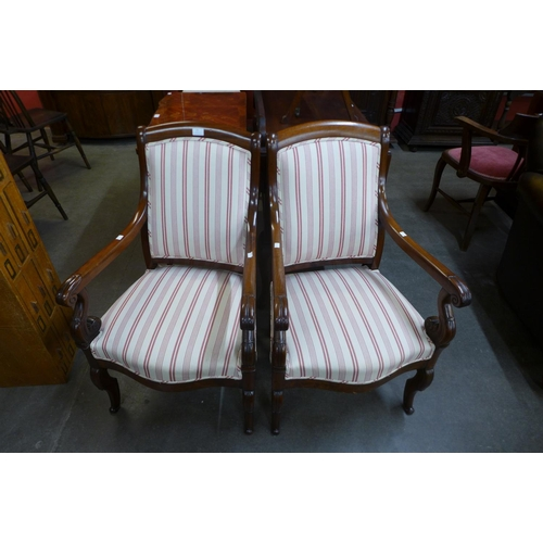 24 - A pair of 19th Century French Empire style mahogany and upholstered fauteuils