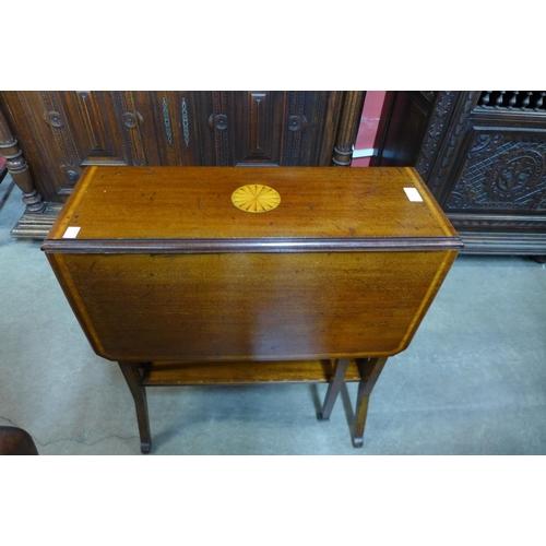 25 - A Victorian inlaid mahogany Sutherland table