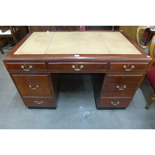 28 - A mahogany and leather topped library desk