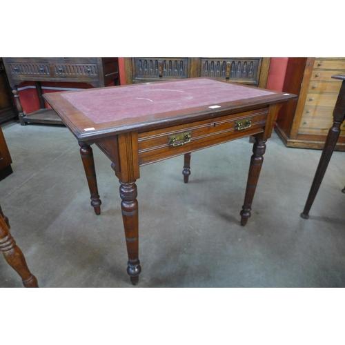 30 - A late Victorian mahogany writing table