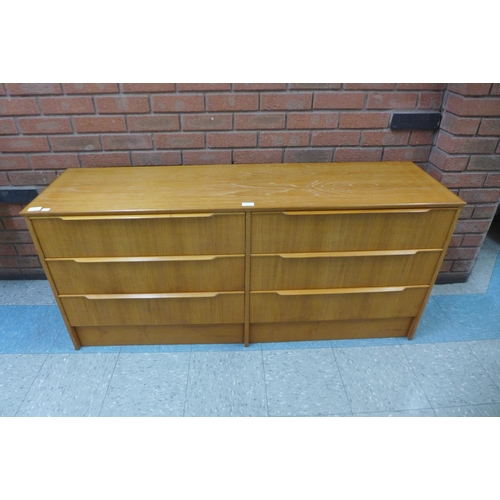 36 - A teak chest of drawers