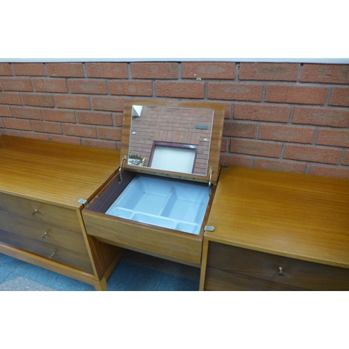 37 - A pair of Uniflex teak and afromosia chests of drawers and modular vanity compartment