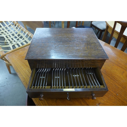 3a - An early 20th Century oak cased Mappin & Webb plated canteen of cutlery