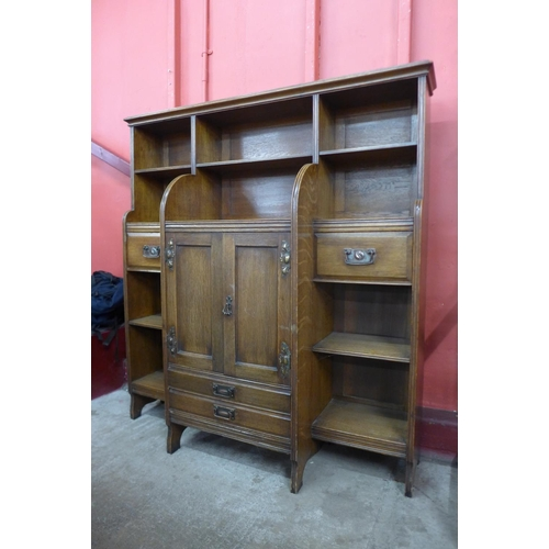4 - An Arts and Crafts oak open breakfront bookcase