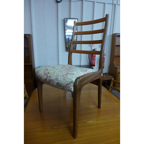 41 - A G-Plan Fresco teak extending dining table and four chairs