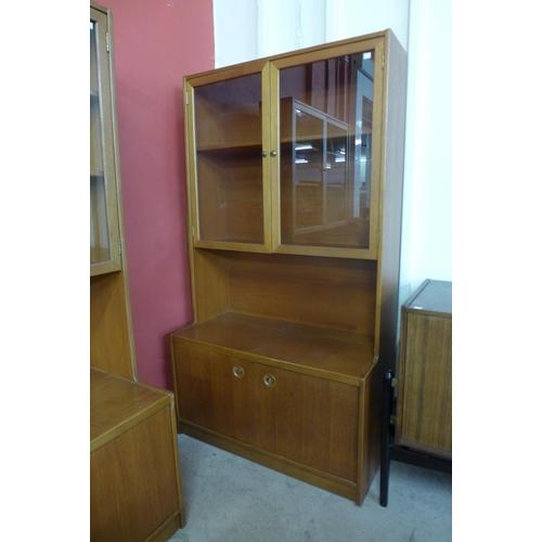 42 - A pair of teak bookcases