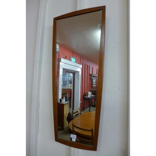 44 - A teak framed mirror