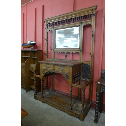 5 - A large Victorian Aesthetic Movement carved oak hallstand