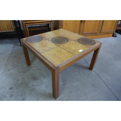 52 - A teak and tiled top square coffee table, a beech nest of tables, a beech standard lamp
