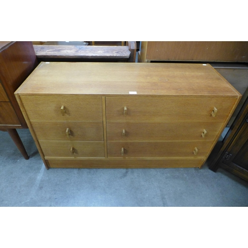 57 - A Stag oak Cantata chest of drawers