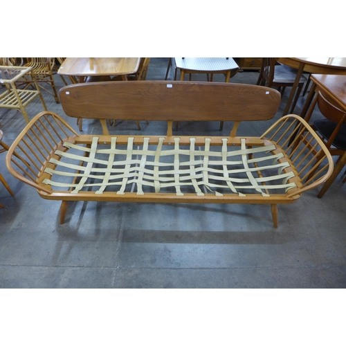 65 - An Ercol Blone elm and beech 355 model studio couch