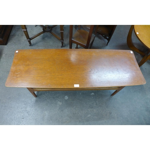 75 - A teak concave ended coffee table
