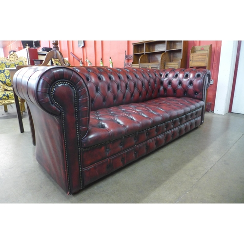 1 - A Chesterfield red leather settee