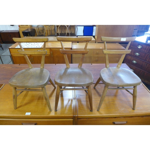 100 - A set of three Ercol child's elm and beech yellow dot stacking chairs