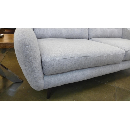 1308 - A Designer grey upholstered three seater sofa