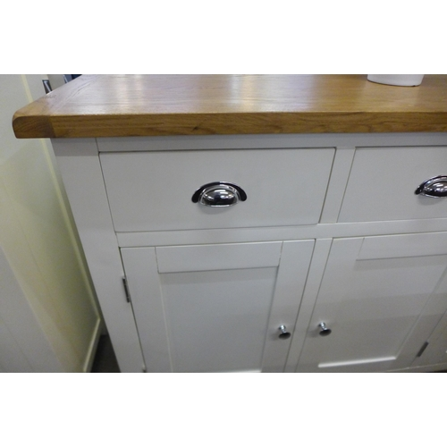 1322 - A Chester white painted oak three door large sideboard (NC-3DS-W)  *This lot is subject to VAT