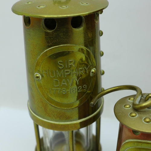 602 - Four small miner's lamps, tallest 17cm
