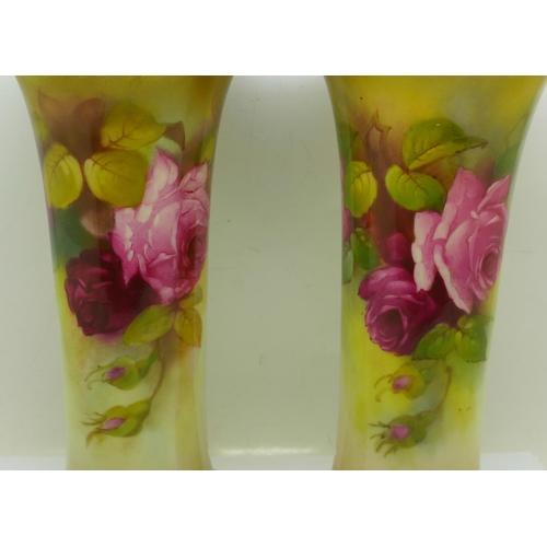 612 - Two Royal Worcester vases, one signed M. Hunt, 23cm