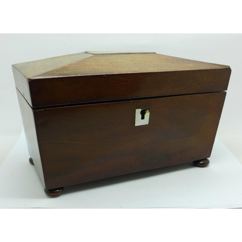 615 - A George IV mahogany tea caddy