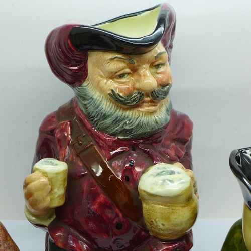 651 - A Royal Doulton Toby jug, Sir John Falstaff, two other Toby jugs and a Russian model of a bear