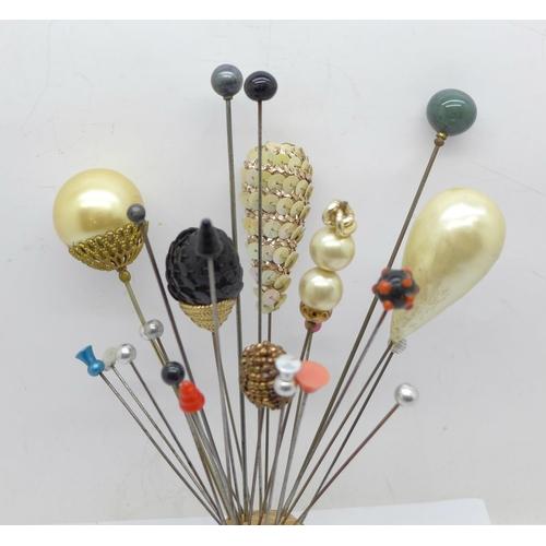 652 - Twenty-five hat pins