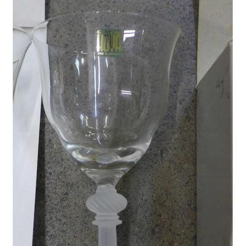 661 - A Bohemian blue glass vase, a pair of Hoya wine glasses and a pair of Hoya shot glasses, boxed