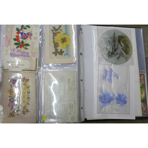 662 - An album of silk and needlework postcards and two framed sets