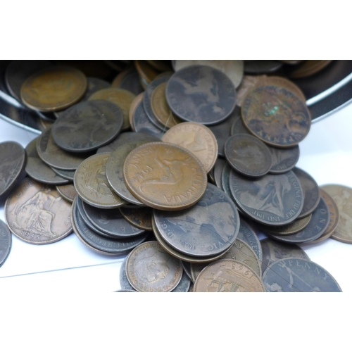 663 - A collection of coins including a tin of pennies and 1902 two shillings, silver three pence, 1/4 rup...
