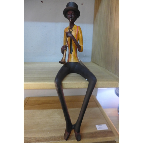 1431 - A sitting jazz band trumpeter, 39cms (026109)   #