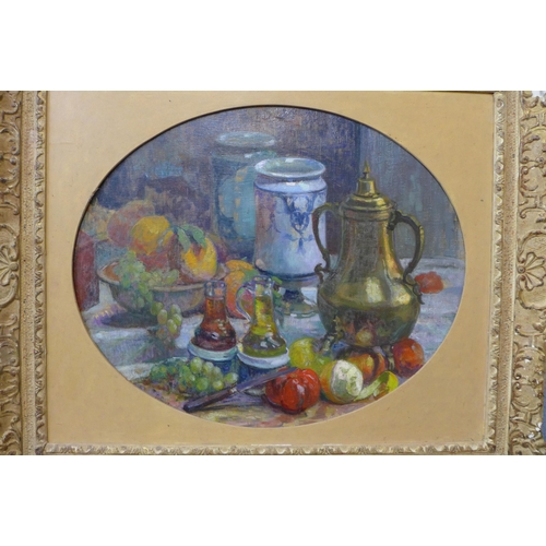 60 - Ferand Guey (French), oval still life of fruit and vessels on a table, oil on canvas, 58 x 71cms, fr...