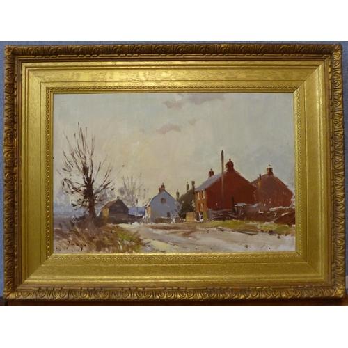 88 - Manner of Edward Seago (1910-1974), winter village landscape, oil on board, 29 x 45cms, framed