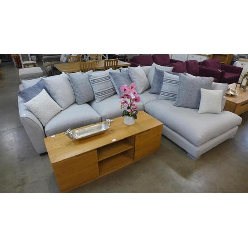 1301 - A designer grey upholstered corner sofa/chrome (scuff to back)