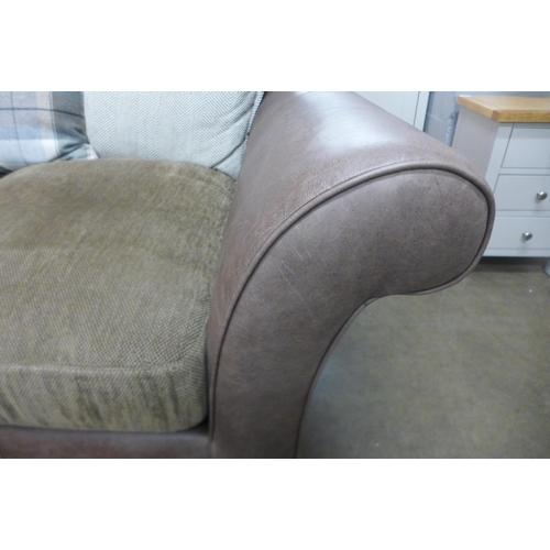 1406 - An Alexander & James two seat designer sofa (some use)