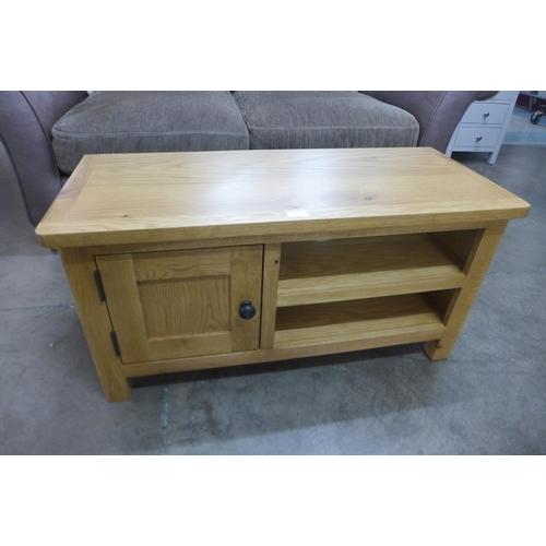 1407 - A Bergen oak single door tv cabinet *This lot is subject to VAT