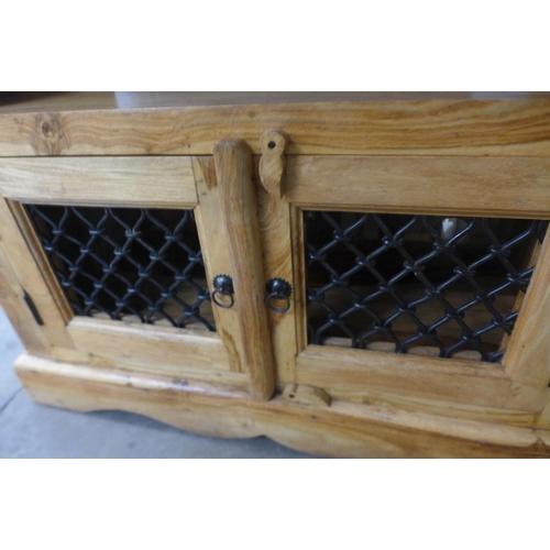 1438 - A hardwood two door TV cabinet