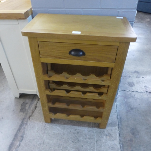 1466 - A rustic oak wine cabinet * this lot is subject to VAT