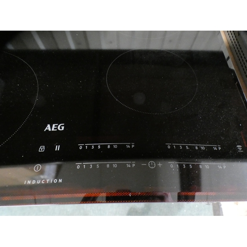 3002 - AEG 4-zone induction hob *This lot is subject to vat