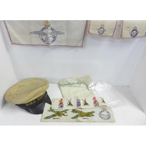 A collection of needlework and embroideries including military themed and a sailor's cap