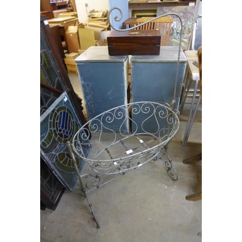 A metal cot / garden planter