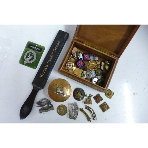 Military and other badges, a silver medallion and a copper military lidded pot, etc.