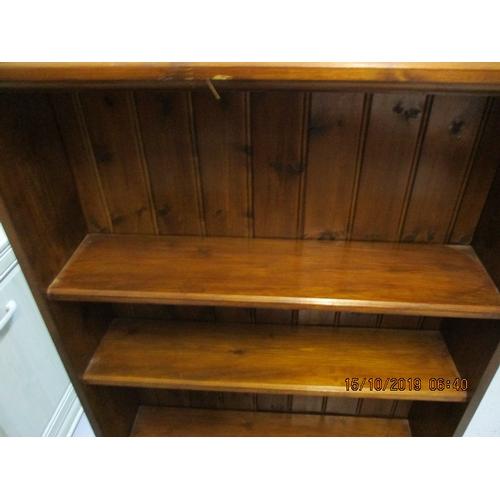 16 - Stained pine bookshelf 125cm high 80cm wide...