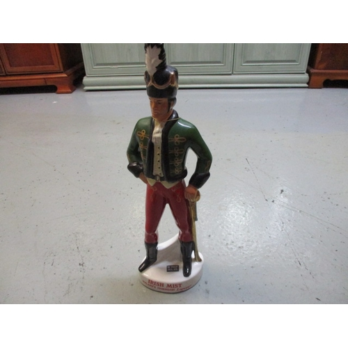 28 - Vintage Irish Mist Decanter featuring an Irish Soldier, 49CM tall. Cork has not been checked  but ap...