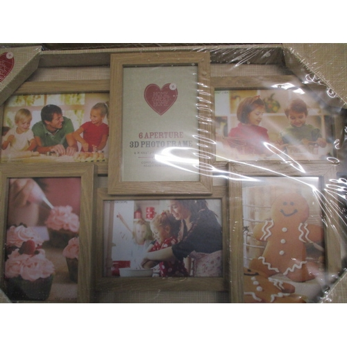 33 - Pair of 3D wooden photo frames, hold 6 photo's each....
