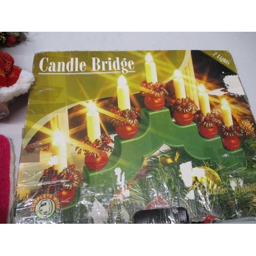 34 - Christmas assortment to include santa, fibre optic santa, knitted santa and sleigh, plus electric ca...